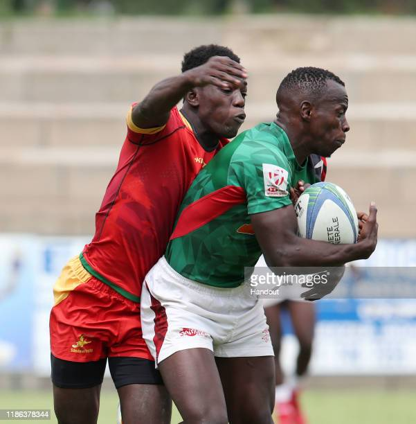 Taabu Daniel of Kenya challenged by Abdousy of Senegal during the 2019 Rugby Africa Mens 7s match between Kenya and Senegal at the Bosman Stadium...