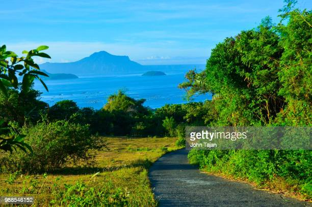 taal volcano is a complex volcano located on the island of luzon in the philippines.[1] it is the se - taal volcano stock photos and pictures
