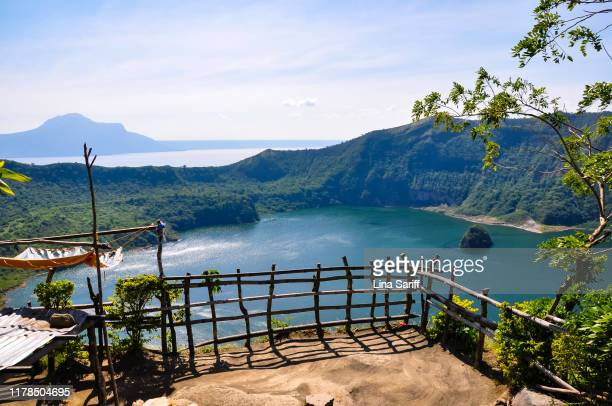 taal volcano observation deck with crater lake view. taal volcano located in tagaytay, philippines. - taal volcano stock photos and pictures