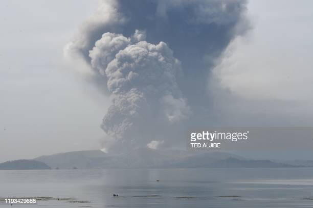 Taal volcano spews ash as seen from Tanauan town in Batangas province south of Manila on January 13 2020 The Philippines was on alert January 13 for...