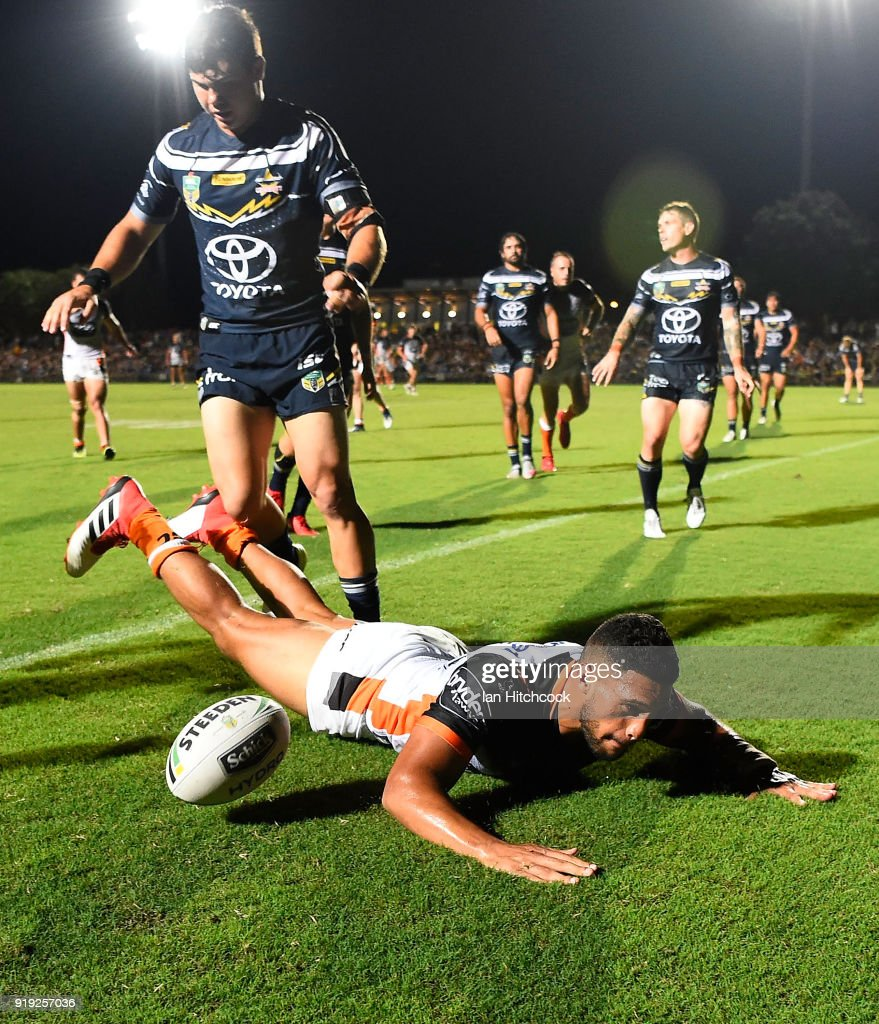 Taane Milne of the Tigers scores a try during the NRL trial match between the North Queensland Cowboys and the Wests Tigers at Barlow Park on February 17, 2018 in Cairns, Australia.