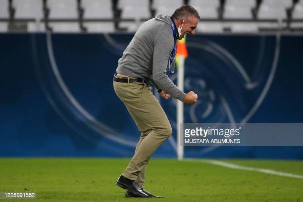 Taawoun's coach Patrice Carteron celerbates his team's win and qualificiation after the AFC Champions League group C match between Qatar's AlDuhail...