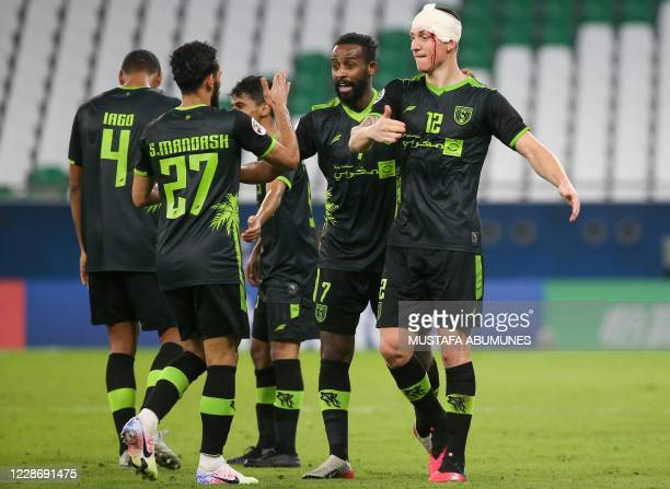 Taawoun's forward Mitchell Duke celebrates after scoring during the AFC Champions League group C match between Qatar's AlDuhail and Saudi's AlTaawoun...