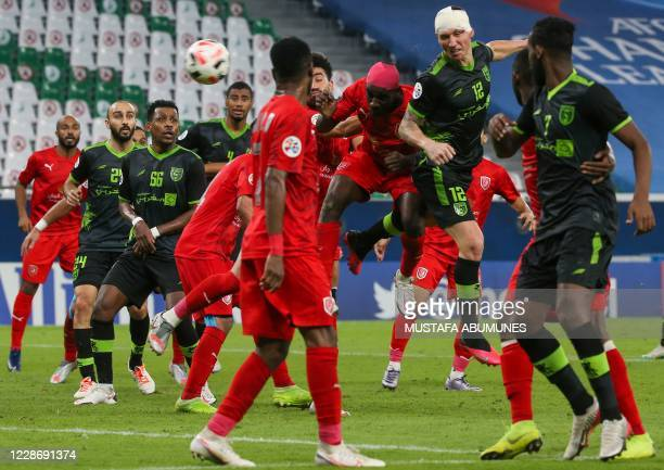Taawoun's forward Mitchell Duke heads th ball during the AFC Champions League group C match between Qatar's AlDuhail and Saudi's AlTaawoun on...
