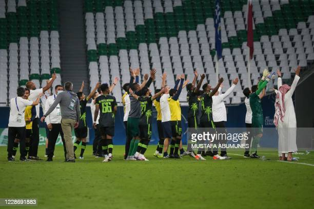 Taawoun's players celebrate their win during the AFC Champions League group C match between Qatar's AlDuhail and Saudi's AlTaawoun on September 24 at...
