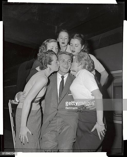 Tab Hunter new Hollywood glamour boy arrived from coast on 20th Century and was greeted by bobby soxers of the Tab Hunter Fan Club He stars with...