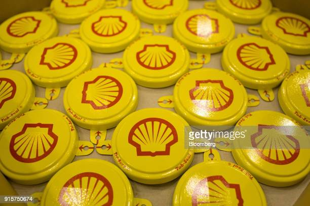 Tab seal caps for oil drums sit in a tray after pressing at the Royal Dutch Shell Plc lubricants blending plant in Torzhok Russia on Wednesday Feb 7...