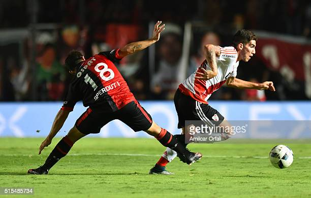 Tabaré Viudez of River Plate fights for the ball with Ezequiel Sperduti of Colon during a match between Colon and River Plate as part of Torneo de...