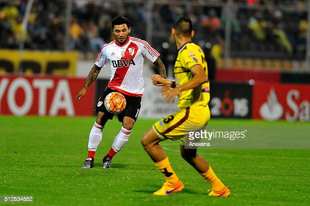 Tabaré Viudez of River Plate fights for the ball with Luigi Erazo of Trujillanos during a group stage match between Trujillanos and River Plate as...
