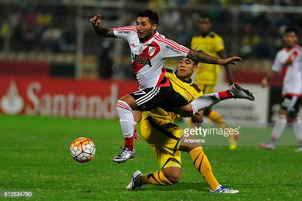 Tabaré Viudez of River Plate struggles for the ball with Maurice Cova of Trujillanos during a group stage match between Trujillanos and River Plate...