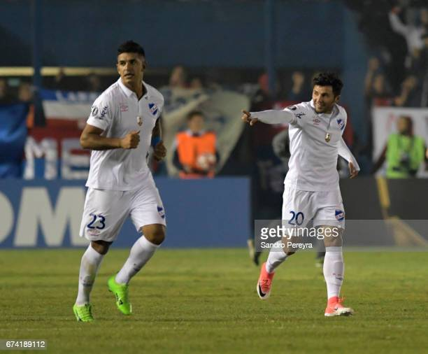 Tabare Viudez of Nacional celebrates his score the third of his team with Diego Polenta during a match between Nacional and Chapecoense as part of...