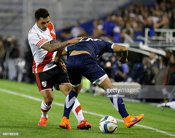 Tabare Viudez of River Plate fights for the ball with Lucas Romero of Velez Sarsfield during a match between Velez Sarsfield and River Plate as part...