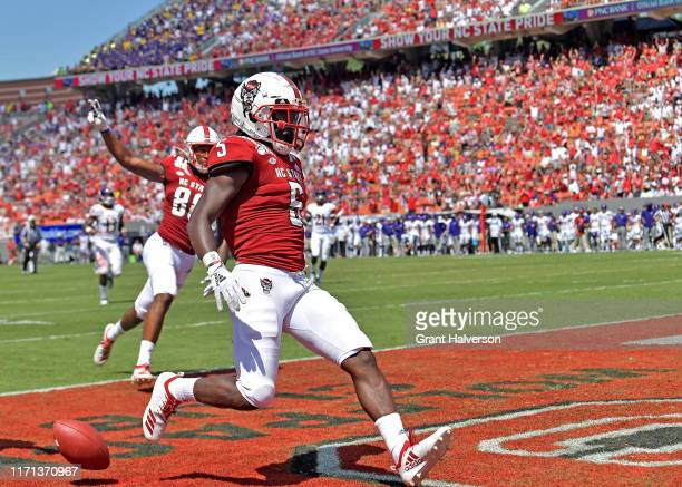 Tabari Hines of the North Carolina State Wolfpack scores a touchdown against the East Carolina Pirates during the second half of their game at...