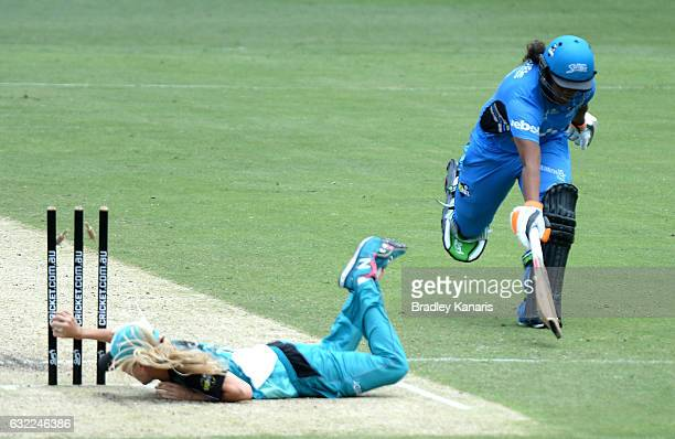 Tabatha Sarille of the Strikers is caught short of her ground by Jemma Barsby of the Heat during the Women's Big Bash League match between the...