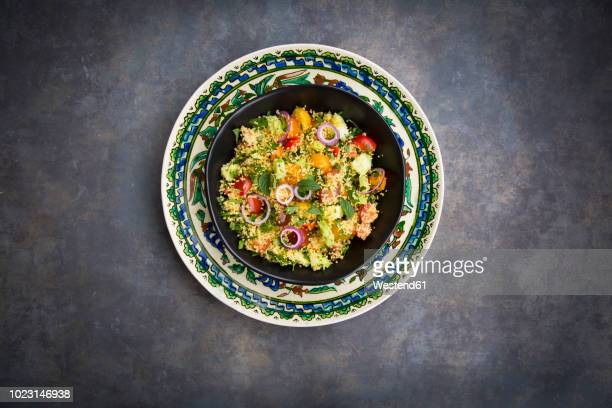 tabbouleh made of couscous, tomatoes, red onions, cucumber, parsley and mint - tabbouleh stock pictures, royalty-free photos & images