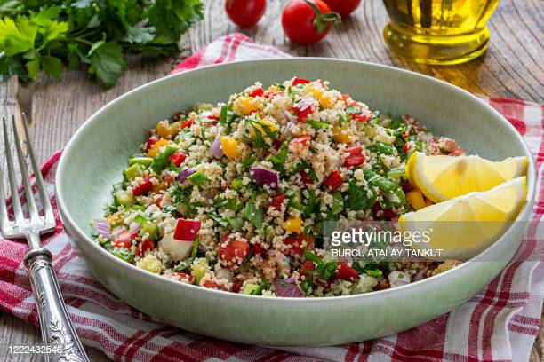 tabbouleh salad with bulgur wheat - vegetarian food stock pictures, royalty-free photos & images