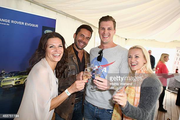Tabea Heynig with boyfriend Oliver Ania Niedieck with boyfriend Christian Hecker attend the Land Rover Public Chill 2014 at km689 on August 17 2014...
