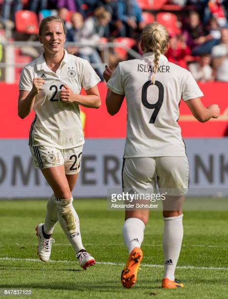 Tabea Kemme of Germany celebrates the fifth goal for her team with her teammates during the 2019 FIFA women's World Championship qualifier match...