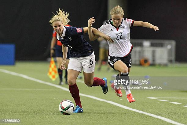 Tabea Kemme of Germany challenges Amandine Henry of France during the FIFA Women's World Cup Canada 2015 quarter final match between Germany and...