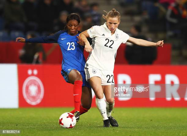 Tabea Kemme of Germany challenges Grace Geyoro of France during the Germany v France Women's International Friendly match at Schueco Arena on...