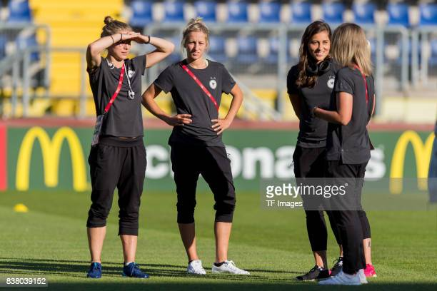 Tabea Kemme of Germany KathrinJulia Hendrich of Germany and Goalkeeper Lisa Weiss of Germany looks on during the Group B match between Germany and...