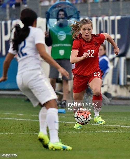 Tabea Kemme of Germany plays against Alex Scott of England in a friendly international match in the Shebelieves Cup at Nissan Stadium on March 6 2016...