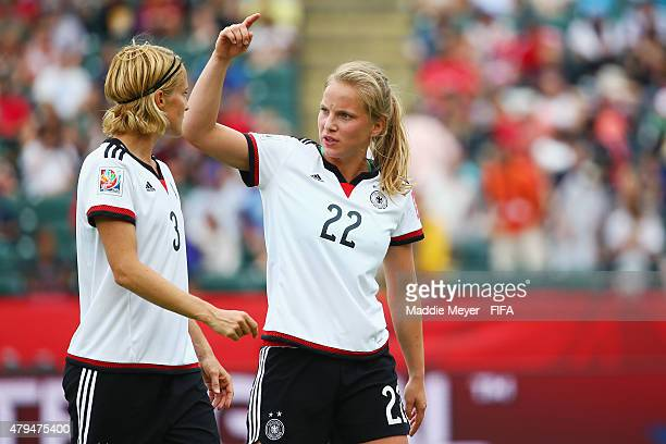 Tabea Kemme of Germany talks with Saskia Bartusiak during the FIFA Women's World Cup 2015 third place playoff match between Germany and England at...