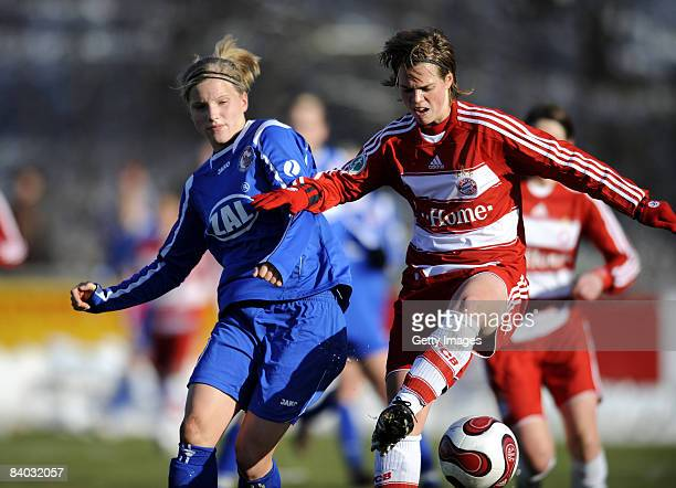 Tabea Kemme of Potsdam and Katharina Baunach of Muenchen challenge for the ball during the Women Bundesliga match between Bayern Muenchen and FFC...