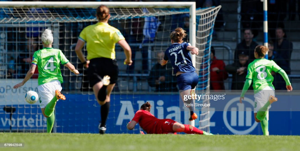 Tabea Kemme of Turbine Potsdam scores her team's first goal against goalkeeper Almuth Schult of VfL Wolfsburg during the Allianz Women's Bundesliga match between Turbine Potsdam and VfL Wolfsburg at Karl-Liebknecht-Stadion on May 7, 2017 in Potsdam, Germany.