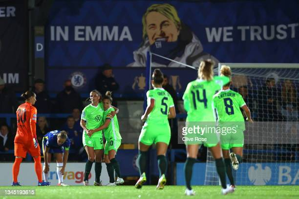 Tabea Wassmuth of VfL Wolfsburg celebrates with Svenja Huth after scoring their side's first goal during the UEFA Women's Champions League group A...