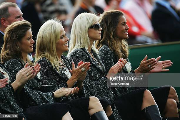 Tabitha Furyk Amy Mickelson Elin Woods and Melissa Lehman applaud during the Opening Ceremony of the 2006 Ryder Cup at The K Club on September 21...
