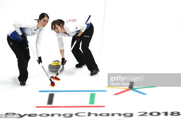Tabitha Peterson and Aileen Geving of the United States of America sweep the ice against Japan during Women's Round Robin Session 1 on day five of...