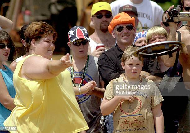 Tabitha Wright, left, competes in the Hupcap Hurl event during the 6th annual Summer Redneck Games July 7, 2001 in East Dublin, Georgia.