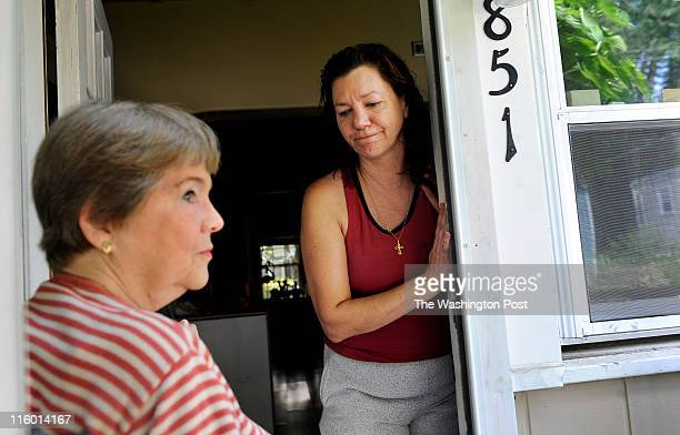 Tabitha Yothers left visits the home of neighbor Lisa Remick on June 08 2011 in Falls Church VA The women are part of small group of residents...