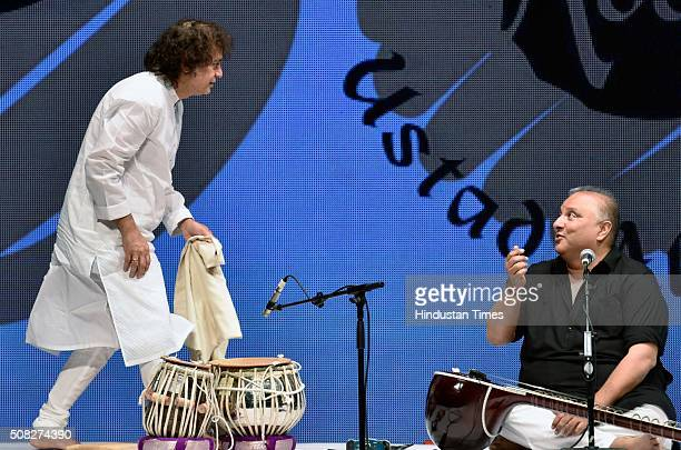 """Tabla maestro Zakir Hussain and Ustad Shujat Khan during a special concert titled """"Homage to Abbaji"""" Father of Ustad Zakir Hussain at Shanmukhananda..."""