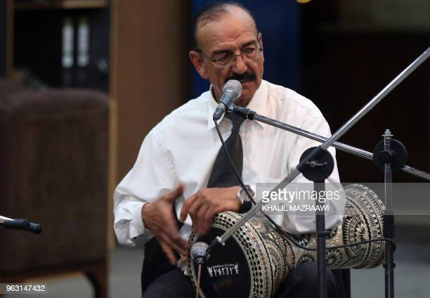 Tabla player Saeed Hana performs with the Beit alRowwad ensemble during a concert at Hussein Cultural Center in Amman on March 13 2018 Beit alRowwad...