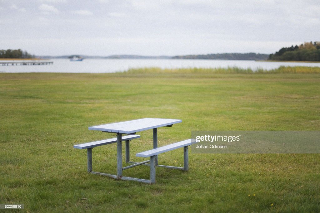 A table and a bench by a lake Sweden. : Stock Photo