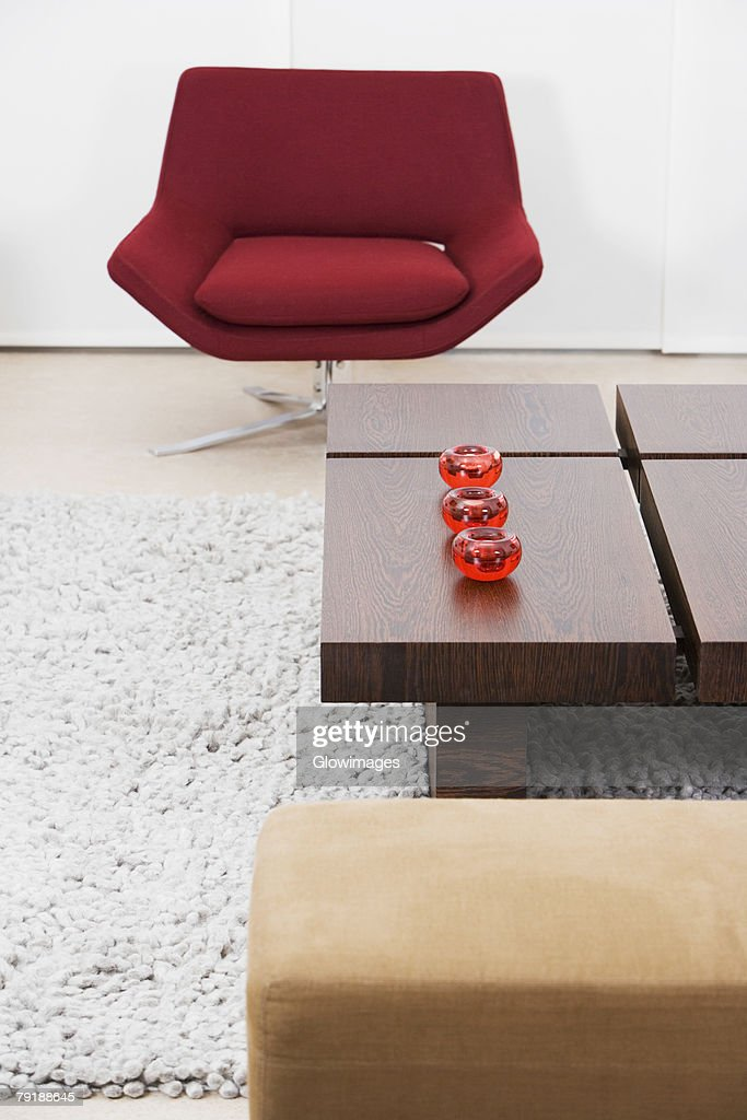 Table and an armchair in a living room : Foto de stock