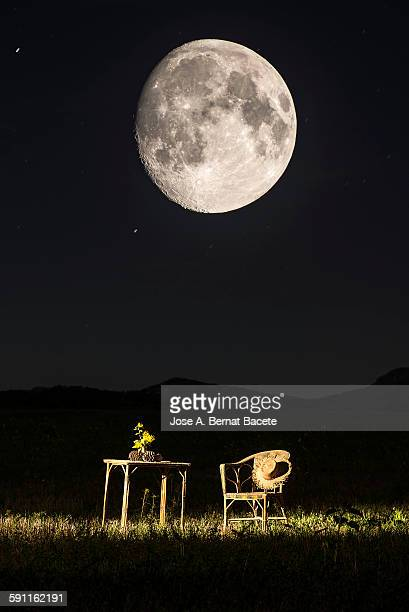 Table and armchair of picnic under the moon