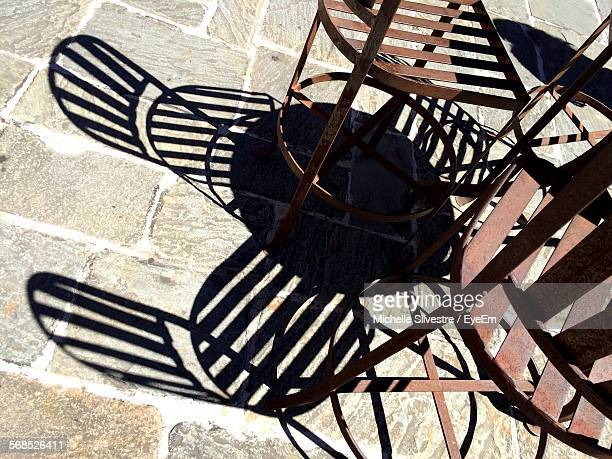Table And Chairs Casting Shadow In Sun