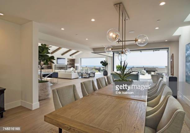 table and chairs in luxury dining room - dining room stock photos and pictures