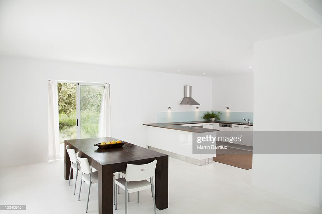 Table and chairs in modern kitchen : Stock Photo