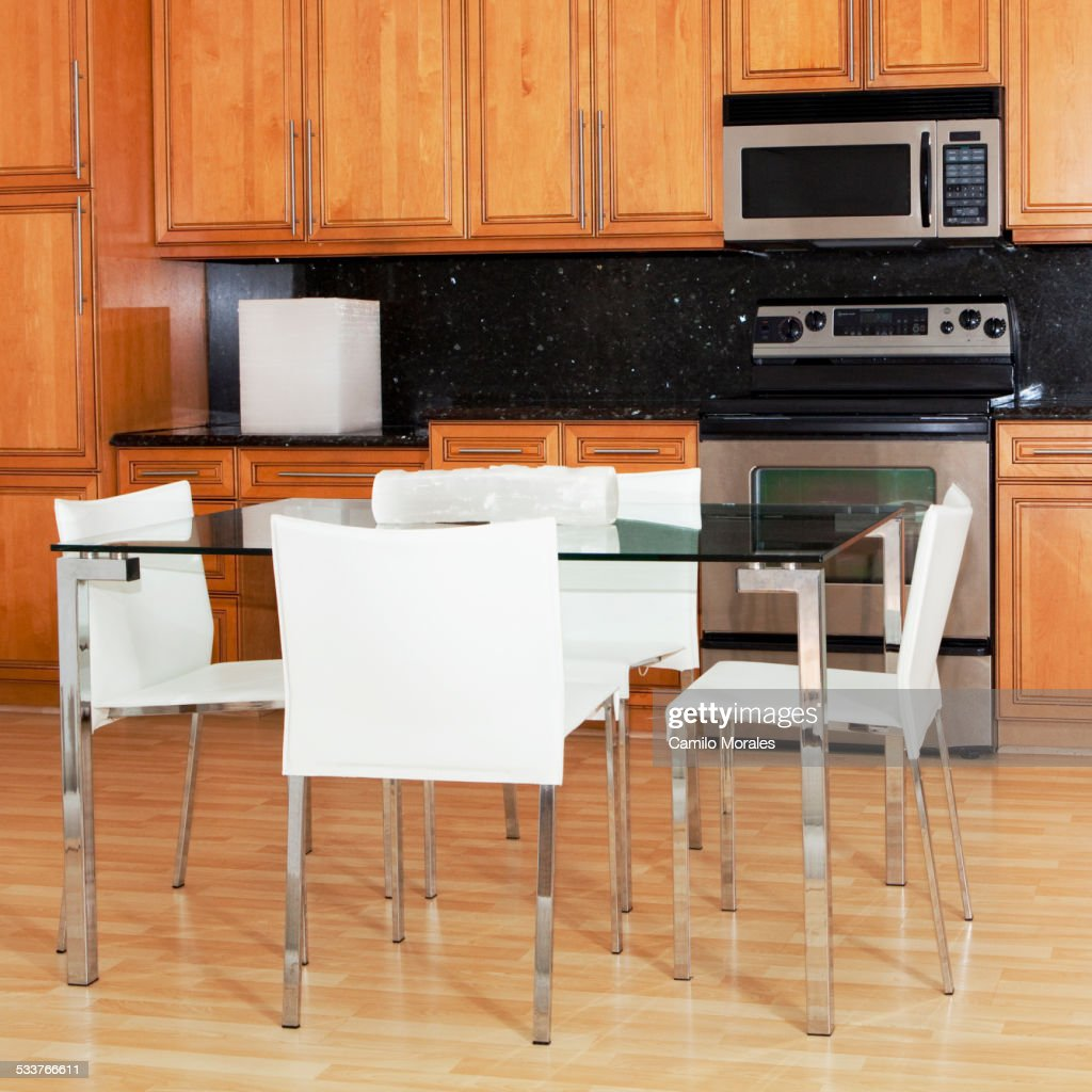 Table and chairs in modern kitchen : Foto stock