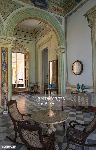 Table and chairs in ornate room