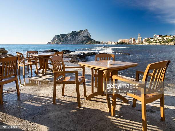 Table and chairs of a terrace of bar close to the coast