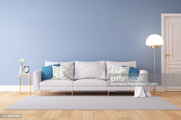 table and chairs on hardwood floor at home - sofa stock-fotos und bilder