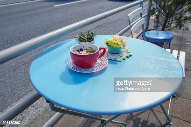 Table and chairs on sidewalk