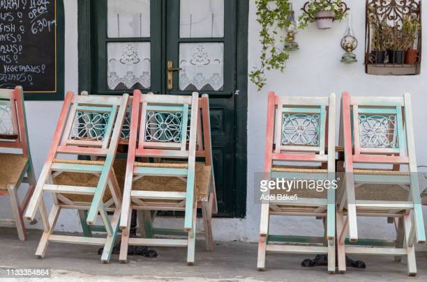 table and chairs (hydra, greece) - hydra greece photos stock pictures, royalty-free photos & images