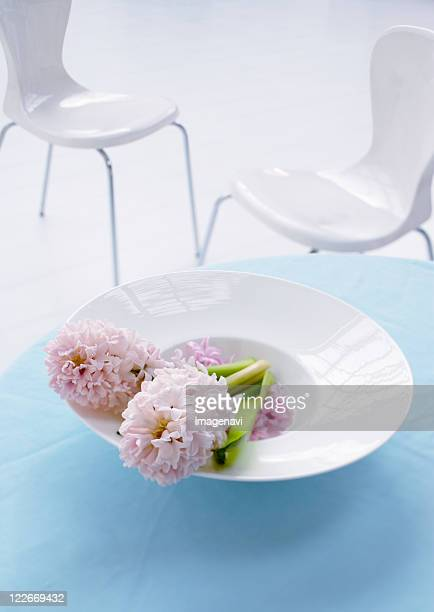 table and chairs with flower - pale pink stock pictures, royalty-free photos & images