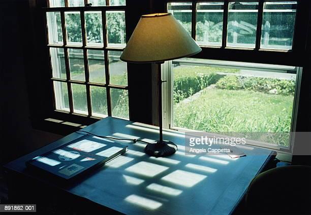 Table and lamp inside historic farmhouse, New Hampshire, USA